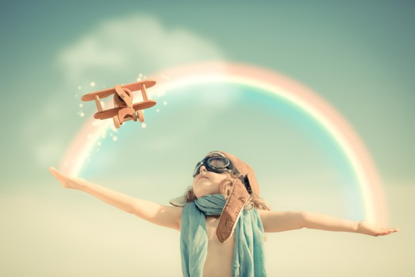 http://www.dreamstime.com/royalty-free-stock-image-happy-kid-playing-toy-airplane-against-summer-sky-background-image32835766